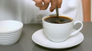 stock-footage-hand-stirring-cup-of-coffee-close-up-in-slow-motion