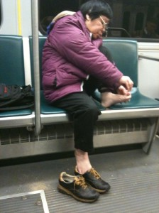 clipping-toenails-on-the-subway