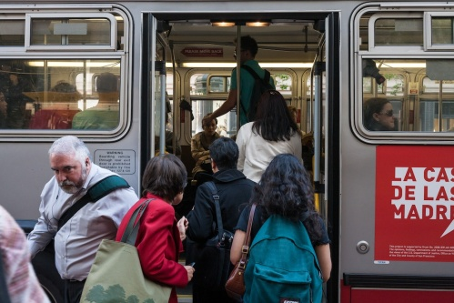 Riders board through the back door of 38 Geary bus during afternoon rush hour. 05/08/12, Market and Post